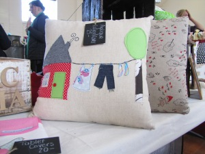 Beautiful applique cushion cover.